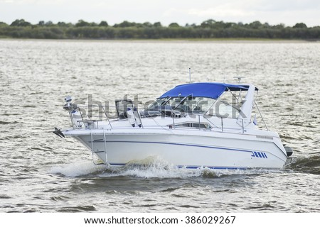motor boat floats on the river - stock photo