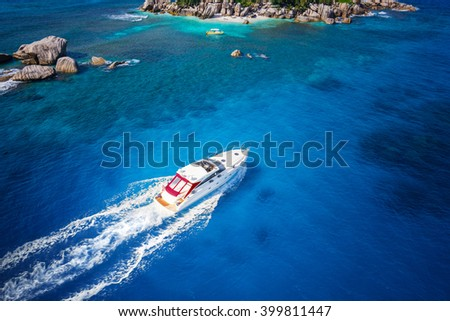 Motor boat in amazing colorful water of Seychelles Coco Island nature - stock photo