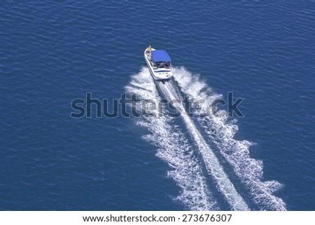 Motor boat on a blue Adriatic sea, Croatia - stock photo