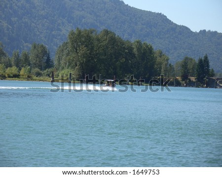Motor Boat on the River - stock photo