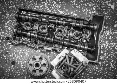 motor cover with spare parts - stock photo