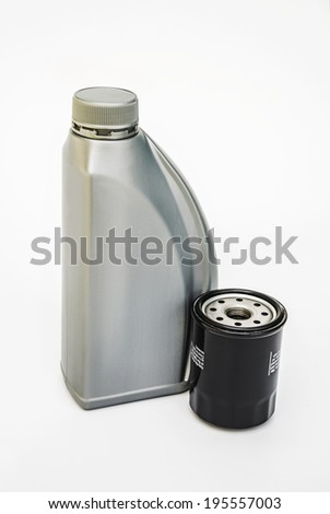 Motor oil bottle and oil filter  - stock photo