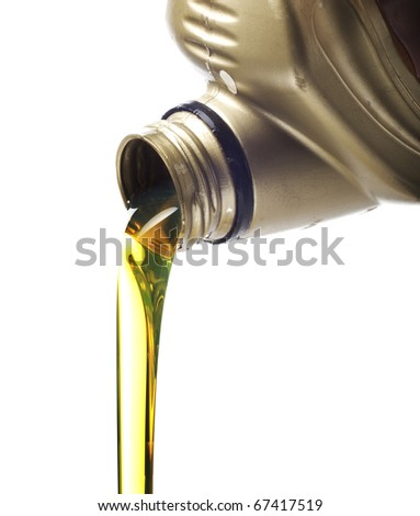 Motor oil poring over white background - stock photo