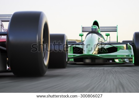 Motor sports race car competitive close quarters racing on a track with motion blur - stock photo