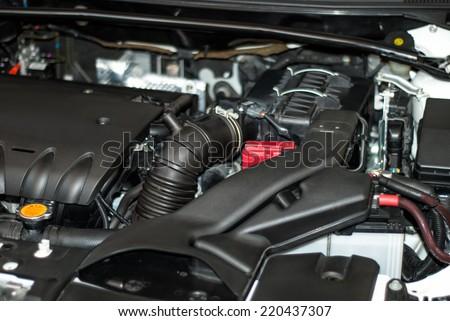 motor vehicle under the hood - stock photo