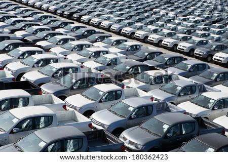 Motor vehicles in storage yard. - stock photo