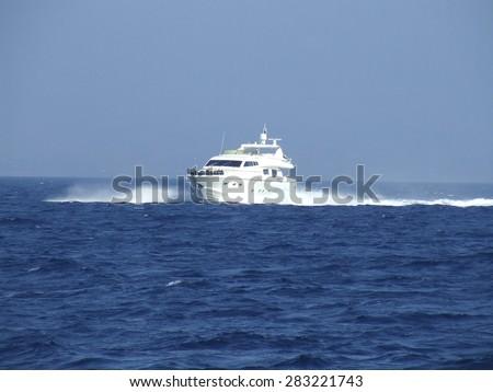 Motor Yacht at high speed - stock photo