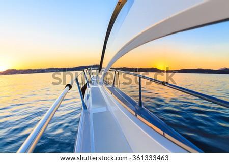 motor yacht at sunset - stock photo