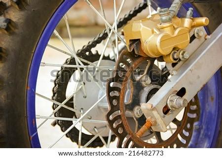Motorbike's rear brake system. - stock photo