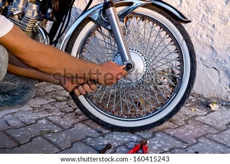 Motorbike Tire Repair - stock photo