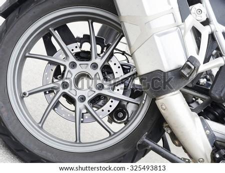 Motorbike wheel detail. - stock photo