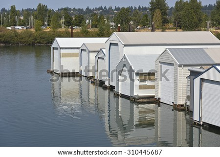 Motorboat garages, storage in a river inlet Portland Oregon. - stock photo