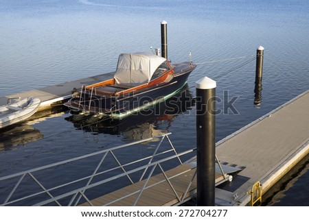 Motorboat on a jetty - stock photo