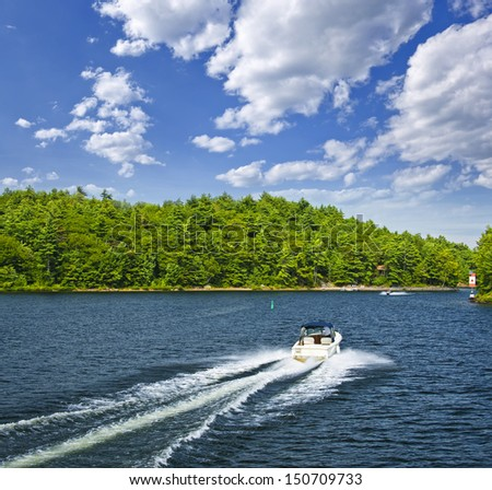 Motorboat on summer lake in Georgian Bay, Ontario, Canada - stock photo
