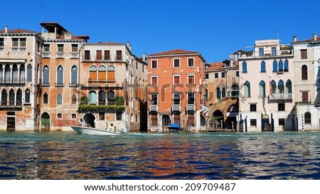 motorboat on the Grand Canal in Venice, Italy - stock photo
