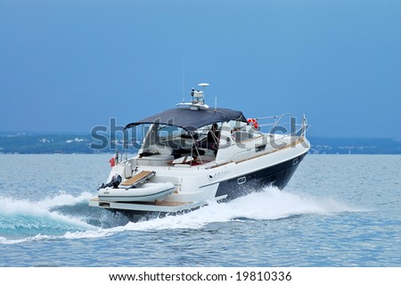 Motorboat on the route on Adriatic - stock photo