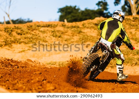 Motorcycle acceleration in dirt track - stock photo