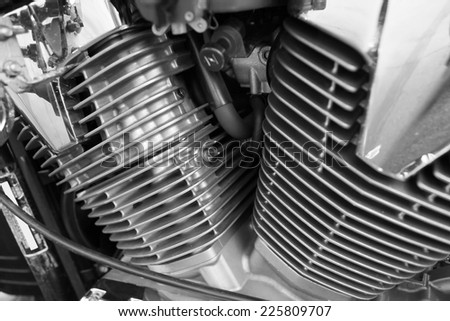 Motorcycle engine, metallic background with exhaust pipes  - stock photo