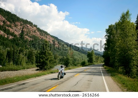 Motorcycle on Mountain Road in Colorado - stock photo