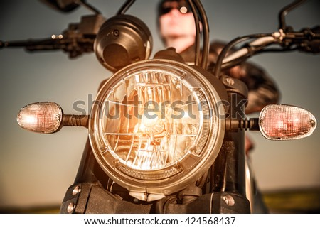 Motorcycle on the road motorcycle headlamp closeup - stock photo