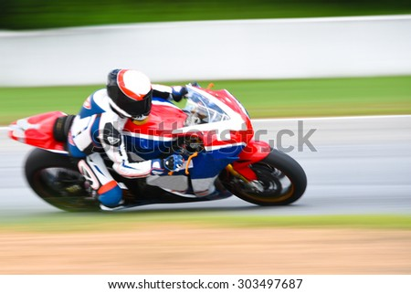 motorcycle racing - blurred background motion blur - stock photo