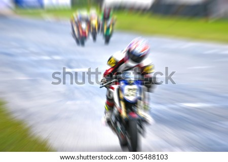motorcycle racing -  winning leadership competing effort - blurred background motion blur - stock photo