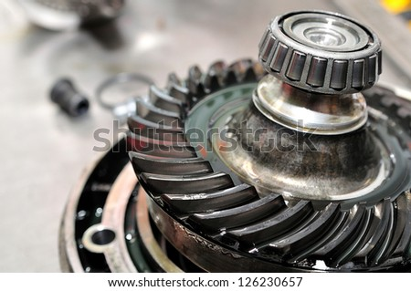 Motorcycle sprocket drive with selective focus. - stock photo
