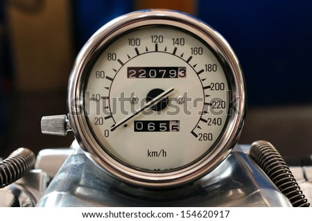 Motorcycle tachometer with chrome ring and white dial. - stock photo