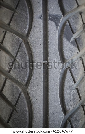 Motorcycle tires A zigzag pattern to increase the adhesion the road surface. - stock photo