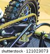 motorcycle wheel and drive-chain - stock photo