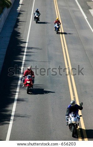 Motorcycles on highway - stock photo
