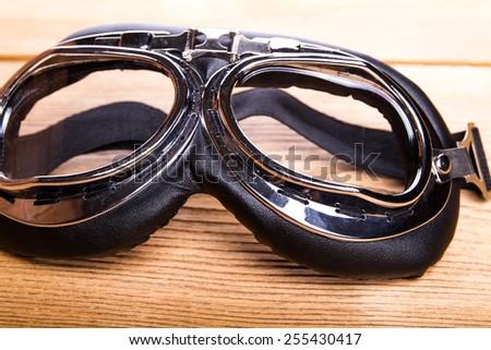 Motorcycles, pilot retro goggles - stock photo