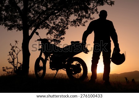 motorcyclist log - stock photo