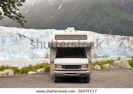 motorhome in front of glacier - stock photo