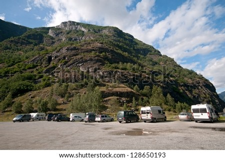 Motorhomes at campsite by Sognefjord, Aurland, Norway - stock photo