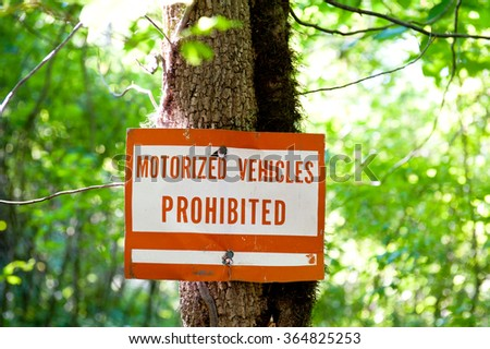 Motorized vehicles prohibited sign in the woods - stock photo
