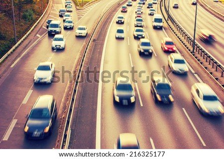 Motorway during Rush Hour with a retro vintage instagram filter effect - stock photo