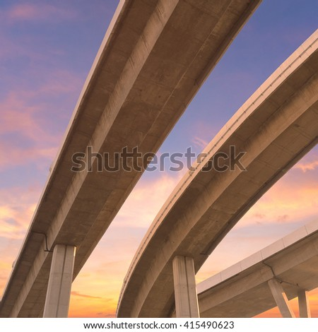 Motorway, Expressway, Freeway the infrastructure for transportation in modern city, urban view against the sunset sky - stock photo