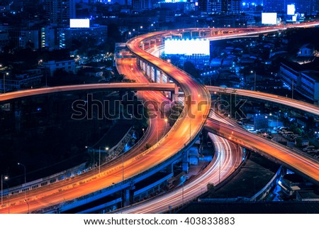 Motorway, Expressway, Freeway the infrastructure for transportation in modern city, urban view at twilight time - stock photo