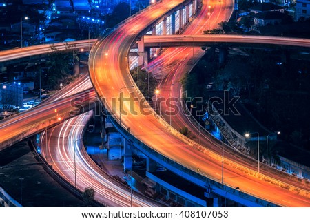 Motorway, Expressway, Freeway the infrastructure for transportation in modern city, urban view at night time - stock photo