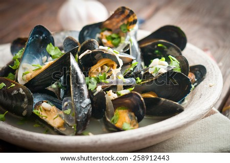 Moules Marinieres - Mussels cooked with white wine sauce. - stock photo