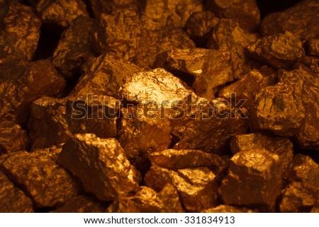 mound of gold close-up on black background - stock photo