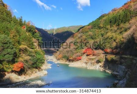 Mount Arashiyama and Oi river in Autumn season - stock photo