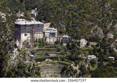 MOUNT ATHOS, GREECE - MAY, 2 : Air photo of Simonos Petras Monastery on Holy Mount Athos on May 2, 2011 Mount Athos, Greece - stock photo