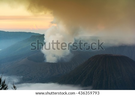 Mount Bromo spewing volcanic ashes from its crater at Bromo-Tengger-Semeru National Park, East java, Indonesia - stock photo