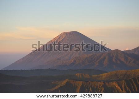 Mount Bromo volcano during sunrise - stock photo