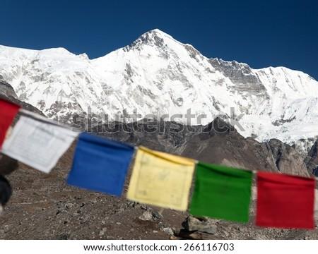 Mount Cho Oyu with prayer flags - way to Cho Oyu base camp - Everest area, Sagarmatha national park, Khumbu valley, Nepal  - stock photo