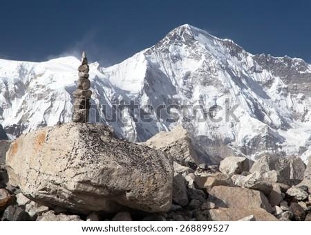 Mount Cho Oyu with stone man - way to Cho Oyu base camp - Everest area, Sagarmatha national park, Khumbu valley, Nepal  - stock photo