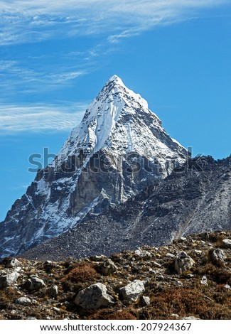 Mount Chola (6069 m) in the area of Cho Oyu - Gokyo region, Nepal, Himalayas - stock photo