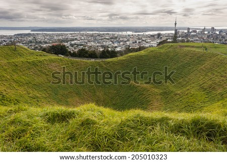 Mount Eden crater with Auckland panorama in background - stock photo